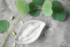 Bowl with body cream. On grey textured background Royalty Free Stock Photography