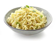 Bowl of boiled egg noodles with spices and herbs royalty free stock photos