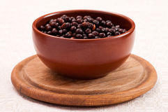 Bowl with boiled grey peas. Ceramic bowl full of boiled grey peas Stock Photo