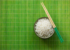 Bowl of boiled rice with chopsticks Royalty Free Stock Photography