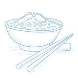 Bowl of boiled rice with chopsticks. Stock Photography