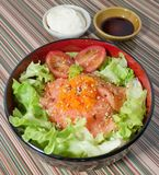 Bowl of Boiled Rice Topping with Salmon and Vegetable Stock Photo