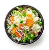 Bowl of boiled rice with vegetables. Isolated on white background, top view royalty free stock images