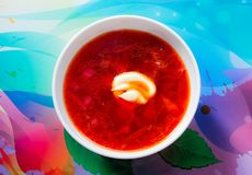 A plate of borscht on the table royalty free stock photography