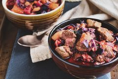 Bowl of Borscht Soup with Meaty Chunks of Beef. Bowl of Borscht soup with hearty, meaty chunks of beef, root vegetables, cabbage and beets. High angle view royalty free stock image