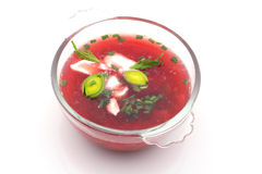 Bowl with borshch, Russian soup, isolated. Beetroot-coloured soup in a glass bowl with sour cream and leek, Russian cuisine Royalty Free Stock Photos