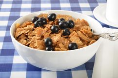 Bowl of bran and corn flakes with blueberries Stock Photos