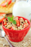 Bowl of bran flakes with strawberries Royalty Free Stock Photo
