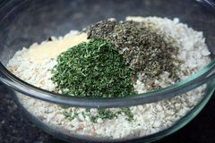 Bowl of Bread Crumbs. Glass Bowl of Bread Crumbs and Seasoning Ingredients Stock Image