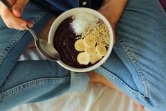 Bowl breakfast in the bed. Breakfast girl a bowl. stock image