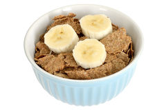 Bowl of Breakfast Bran Flakes Cereals with Banana Royalty Free Stock Photo