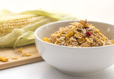 Bowl of Breakfast Cereal and Corn Cob. Stock Photos