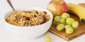 Bowl of Breakfast Cereal and Fresh Fruit. Royalty Free Stock Photography