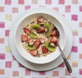 Bowl of Breakfast Cereal with Fresh Fruit. Stock Photos