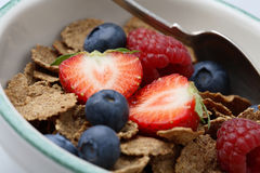 Bowl of breakfast cereal with fruit. Royalty Free Stock Photo