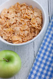 Bowl of breakfast cereal in a rustic setting Stock Image