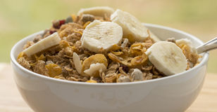 Bowl of Breakfast Cereal with Slices of Banana. Stock Image