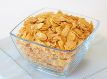 Bowl of breakfast cornflakes. Glass Bowl of breakfast cornflakes Royalty Free Stock Image