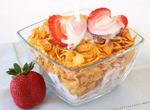Bowl of breakfast cornflakes with strawberries. And milk Stock Photos