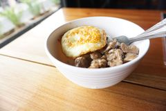 Breakfast with egg and beef. A bowl of the breakfast menu with beef and eggs close up and delicious looks detail of its food Royalty Free Stock Images