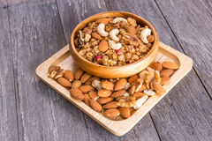 Bowl of breakfast muesli mixed with dried fruit and nuts in a wo Royalty Free Stock Images