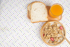 Bowl of breakfast muesli with oat and wheat flakes mixed with dried fruit and nuts in a wooden  bowl. Royalty Free Stock Photos
