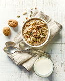 Bowl of breakfast porridge with nuts Stock Photo
