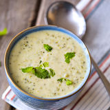Bowl of broccoli and cheddar cheese soup Stock Photography