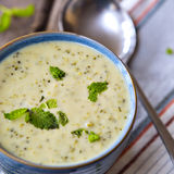 Bowl of broccoli and cheddar cheese soup Stock Photo