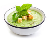 Bowl of broccoli and green peas cream soup Royalty Free Stock Image