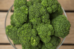Bowl of Broccoli. Bowl of scalded broccoli on wood Royalty Free Stock Image