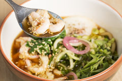 Bowl with broth, shrimp and fesh parsley Stock Photography