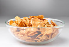 Bowl with brown cereal flakes Stock Images