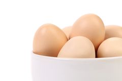 Bowl with brown eggs. Fragment. Stock Photography
