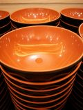 Bowl with brown inner side and black outside. They are arranged stock photography