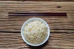 Bowl of brown rice with chopsticks Stock Photography