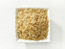 Bowl of brown rice grains Royalty Free Stock Photos