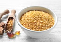 Bowl with brown sugar. On wooden background Stock Photo