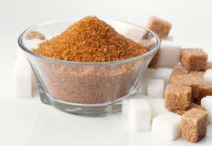 Bowl of brown sugar and sugar cubes surround Royalty Free Stock Photo