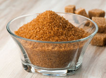 Bowl of brown sugar and sugar cubes surround Stock Image