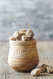 Bowl of brown sugar on the wooden background Royalty Free Stock Photo