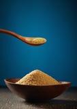 Bowl of brown sugar Stock Images