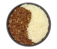Bowl of brown and white rice Stock Photos
