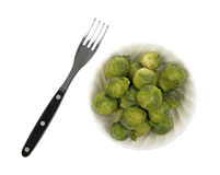 Bowl of Brussels sprouts with fork Stock Photo