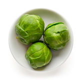 Bowl of Brussels sprouts isolated on white from above Stock Photos