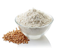 Bowl of buckwheat flour Stock Images