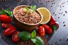 Bowl of buckwheat kasha on wooden table Royalty Free Stock Photography