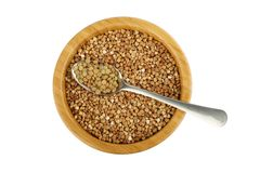 Bowl with buckwheat and spoon with lentil Royalty Free Stock Images