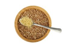 Bowl with buckwheat and spoon with vermicelli Stock Photos