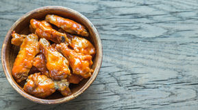 Bowl of buffalo chicken wings. On the wooden table royalty free stock images